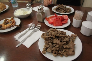 Edirne Cigeri served with yogurt, fried red chillies and tomatoes. very delicious