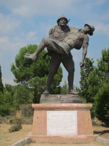 "A Turkish Soldier carrying a wounded Australian soldier, commemorating ""the Last Gentleman's War"""