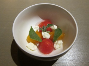 Amuse Bouche of tomatoes and cheese.